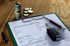 Car insurance contract and money. On wooden table Stock Images