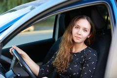 Car insurance driver. Pretty girl. Beauty lady inside. Drive school royalty free stock images