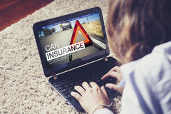 Car insurance in a laptop screen. Stock Photo