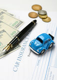 Car insurance policy with pen and money around Royalty Free Stock Photography