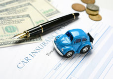 Car insurance policy with pen and money around Stock Photo