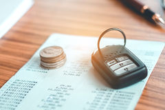 Car insurance,Car remote and account book in finance and banking Stock Photo