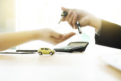 car insurance, sell and buy car, car financing, car key for Vehicle Sales Agreement Stock Photos