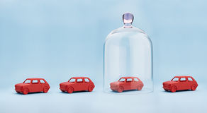 Car insurance. Toy car protected under a glass dome on blue background Royalty Free Stock Photography
