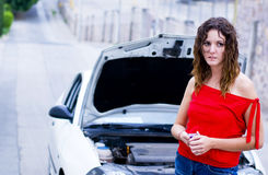 Car insurance waiting. Woman called car insurance help Stock Photography