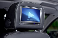 Car interior. Video screen mounted on the back of headrest Royalty Free Stock Images
