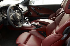 Car interior. Interior of a luxury car with red seats Stock Image