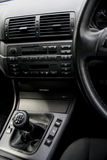 Car interior. Detail of a car interior - gear shift in focus Stock Image