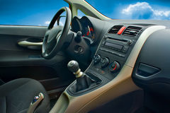 Car interior. Modern car interior - sky with clouds on the background Royalty Free Stock Image