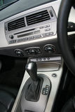Car Interior. Interior of car showing dashboard with radio and steering wheel stock images