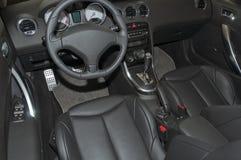 Car interior. The beautiful black interior of New Car royalty free stock image