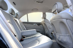 Car interior. Grey leather car saloon with sky and sun in windows Stock Photo