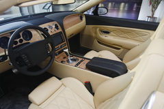 Car interior. Bright leather interior of a new luxury car stock images