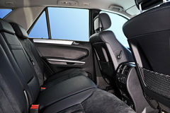 Car interior. Passenger places with leathet and suede sofa Stock Images