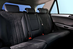 Car interior. Passenger places with leathet and suede sofa Royalty Free Stock Photos