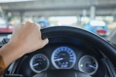 Car interior background young woman drive car with hand. image f. Or vehicle, body, transport, speed concept Stock Photos