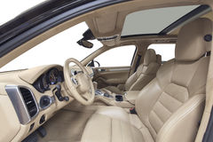 Car interior. Beige cockpit with steel decoration on isolated white background Stock Image