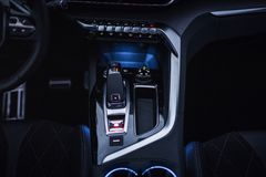 Car Interior: Center Console with dials, buttons and gear knob. A modern car interior, focusing on the controls located on the central console: dials, buttons Royalty Free Stock Photo