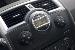 Car interior with climat-control view. Air conditioner display on foreground Stock Photo