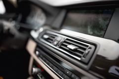 Car interior with close-up of ventilation system holes and air conditioning. Concept wallpaper for auto air conditioning an Royalty Free Stock Photos