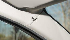 Car interior with closeup of anti-theft alarm sensor. Interior of a car with closeup of anti-theft alarm sensor stock photo