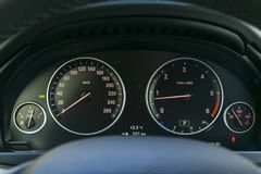 Car interior dashboard details with indication lamps. Car detailing. Car instrument panel. Dashboard closeup with visible. Speedometer and fuel level. Odometer stock images