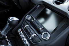 Car interior dashboard and gear shift knob detailed. Gear shift knob, electronic controls and touch screen display at the dashboard inside sport car stock photography
