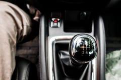 Car interior detail, the gear shift lever. Car interior detail of new car, the gear shift lever Stock Photo