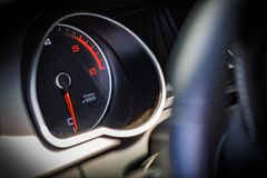 RPM or speed gauge is luxury car interior. Car interior detail, speed gauge or RPM revs gauge close-up Royalty Free Stock Photo