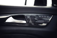 Car interior details. Door handle and electronic memory for the chairs. Royalty Free Stock Photography