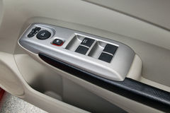 Car interior details of door handle with windows controls and ad Royalty Free Stock Photography