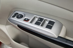 Car interior details of door handle with windows controls and ad Royalty Free Stock Images
