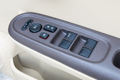 Car interior details of door handle with windows controls and ad Stock Image