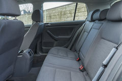 Car interior details. Modern car interior details of rear banch with armrest and headrests Stock Image