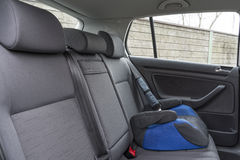 Car interior details. Modern car interior details of rear banch with child seat, headrest belt etc Stock Image