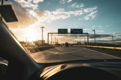 Car interior when driving on a highway in the sunset royalty free stock photography