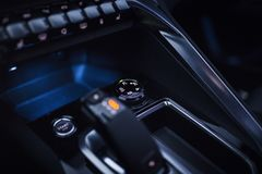 Car Interior: Driving Modes Rotary Controller. Grip Control, a rotary dial that helps you choose the driving mode for improved traction: Mud, Snow, Sand, ESP Off Stock Image