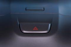 Car interior emergent warning button Stock Photos
