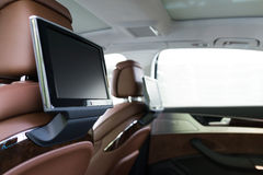 Car interior. Entertainment system,LCD screen hanging on the back of the seat Royalty Free Stock Image