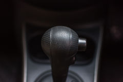 Car interior with gear stick and sport button Royalty Free Stock Photos