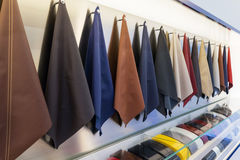 Car interior leather samples. And paint samples at car dealership showroom stock photography