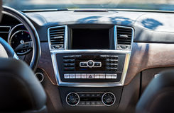 Car interior luxury. Beige comfortable seats. Car interior luxury. Beige comfortable seats, steering wheel, dashboard, climate control, speedometer, display Stock Photos