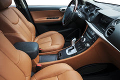 Car interior. The luxury car cab interior , yellow soft leather seats, shift lever,center stack, steering wheel