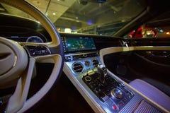 Car interior luxury. Interior of prestige modern car. Dashboard and steering wheel. Focus on steering wheel. Film effect Royalty Free Stock Image
