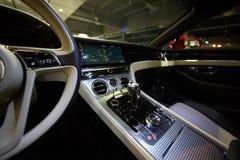 Car interior luxury. Interior of prestige modern car. Dashboard and steering wheel. Focus on steering wheel. Film effect Royalty Free Stock Images