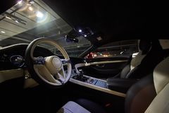 Car interior luxury. Interior of prestige modern car. Dashboard and steering wheel. Focus on steering wheel. Film effect Royalty Free Stock Photos
