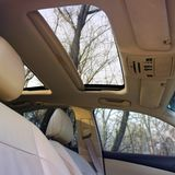 Car interior luxury service. Panoramic car roof stock photos