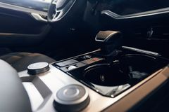 Car interior. Modern car illuminated dashboard. Luxurious car instrument cluster. Close up shot of automobile instrument panel. Modern car interior dashboard stock photo