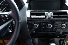 Car interior. Modern car speedometer and dashboard. Luxurious car instrument cluster. Stock Photography