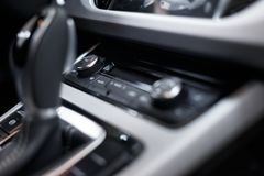 Car interior. Modern car illuminated dashboard. Luxurious car instrument cluster. Close up shot of automobile instrument panel royalty free stock image